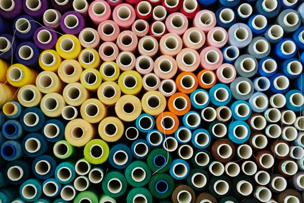 Colorful Sewing Threads Background